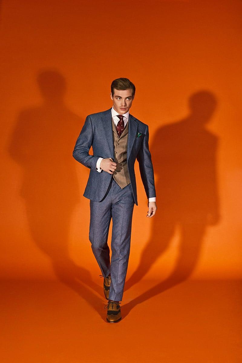 Broken Suit Traje azul con chaleco cafe